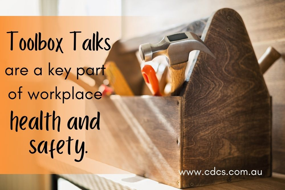 "A wooden toolbox filled with workmen's tools with the text ""Toolbox talks are a key part of workplace health and safety."""