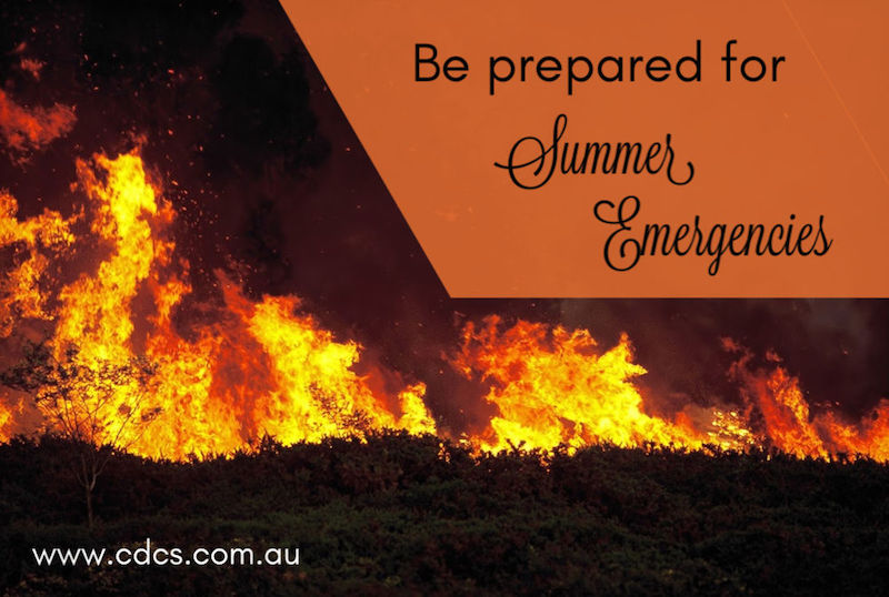 "Wild bushfire burning out of control in native bushland, text says ""Be prepared for summer emergencies"""