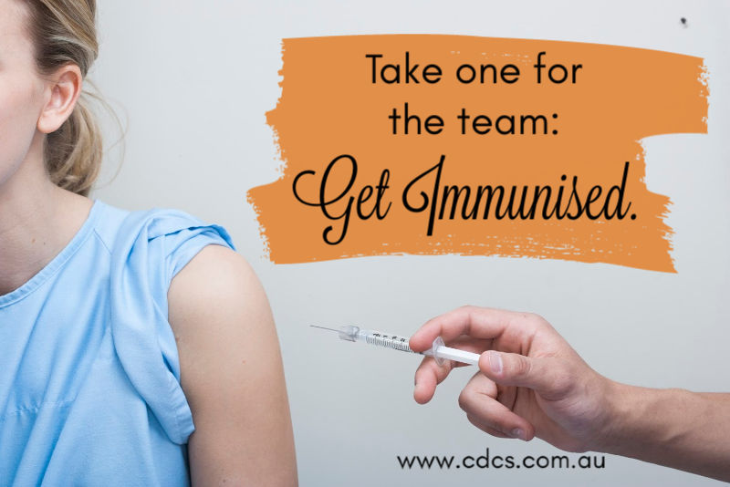 "Patient getting injection, text says ""Take one for the team: get immunised."""