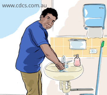 Male indigenous worker washing his hands properly.